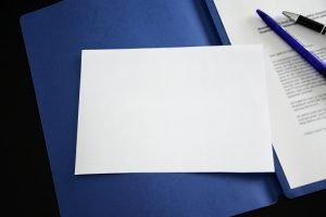 blank notepad for annotations with application portfolio background